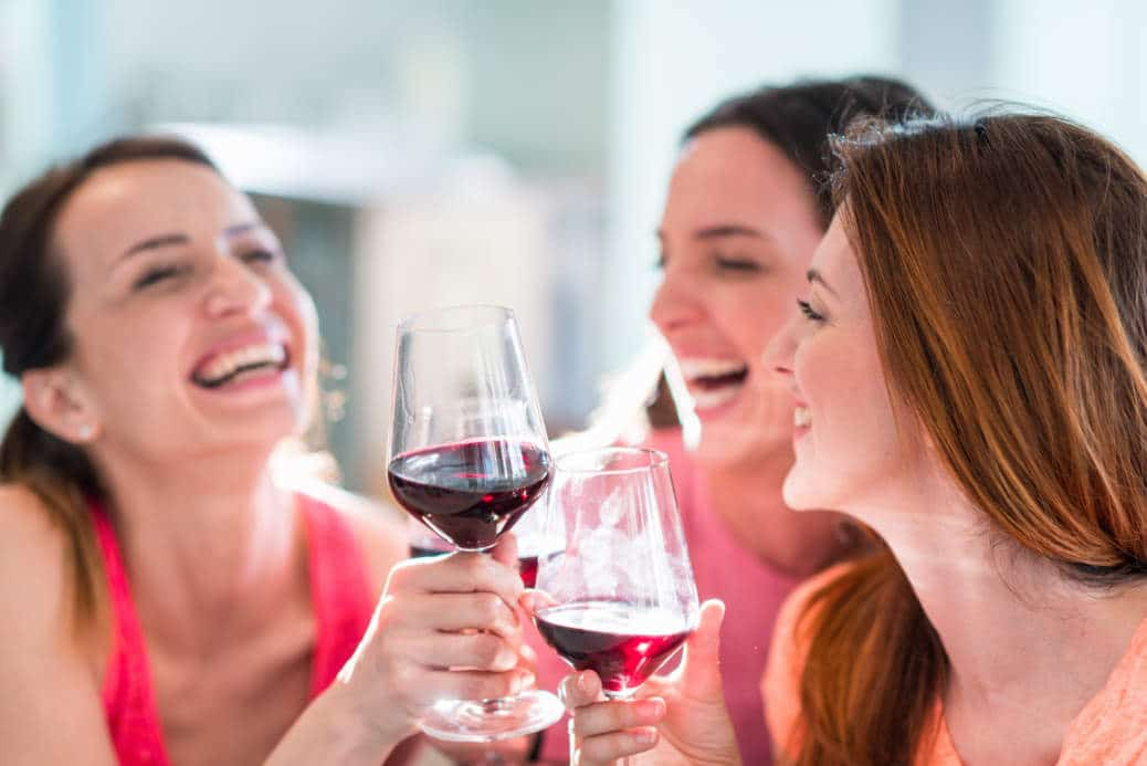 Girls drinking wine in restaurant